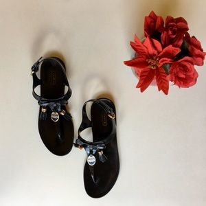 COACH jelly black sandals with gold accents
